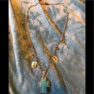 Silver necklace with teal cross